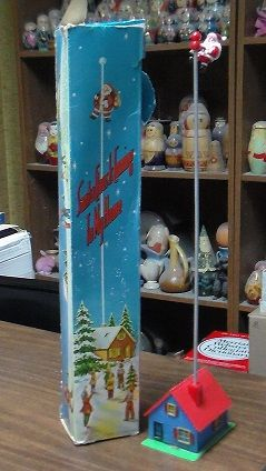 Christmas thing one of my grandmas had. Santa would climb down the pole.