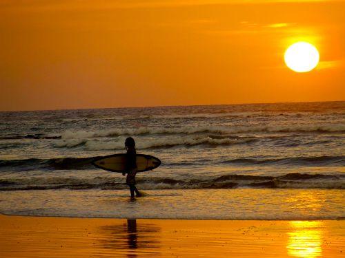 A surfer girl under a Tamarindo sunset #CostaRica #Tamarindo