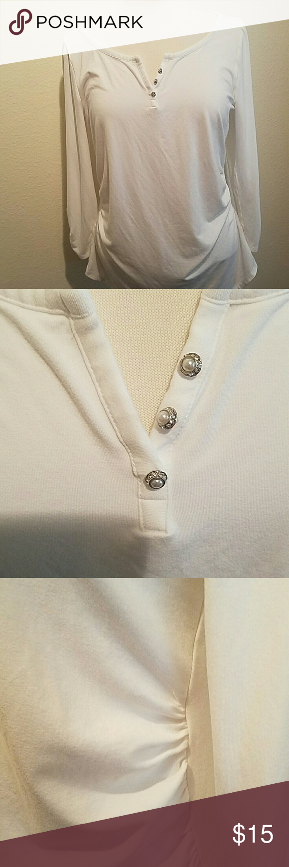 WHBM stretchy top Very figure flattering with ruched sides and sleeves.  Sparkly buttons at neckline.  EUC, no stains or spots. The size tag was cut but is a size large.  Fits a 14 perfect. White House Black Market Tops