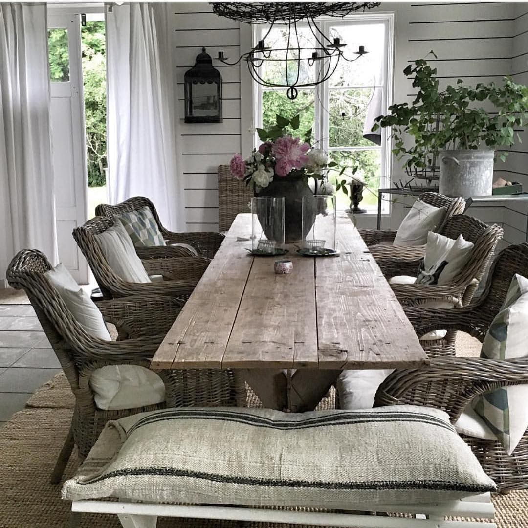 Dining Room With Farmhouse Table And Wicker Chairs