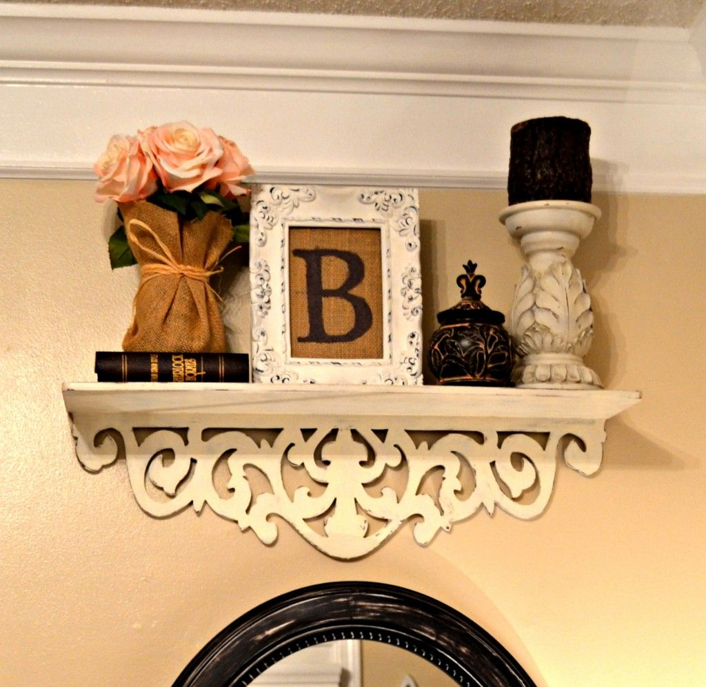 Burlap wrapped flower vase w/shabby chic accents.  Like the combo.