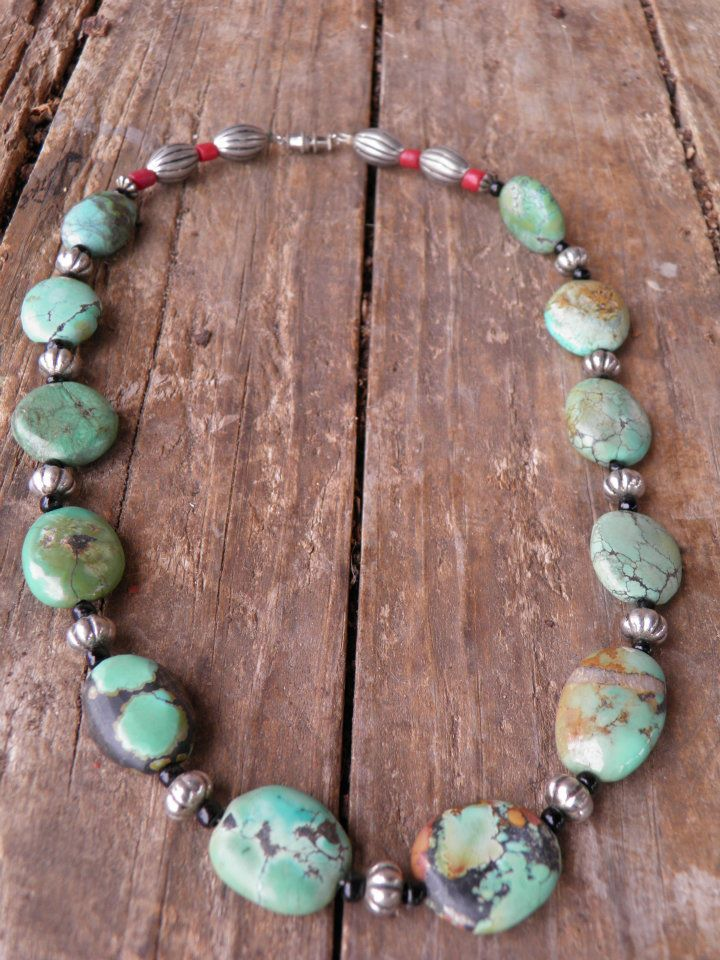 Antiqued fluted round, barrell & rondell silver beads, red clay & black glass seed beads with disk shaped African Turquois beads.