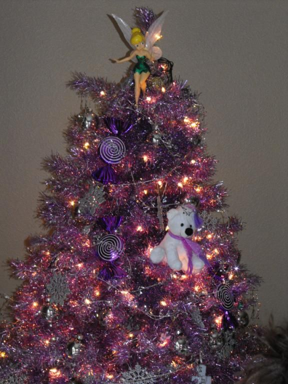 Check out that Tinkerbell tree topper on the Purple Groove Tree, it's a  Disney kinda Christmas! - Purple Groove Tinsel Tree Pinterest Tree Toppers, Tinkerbell And