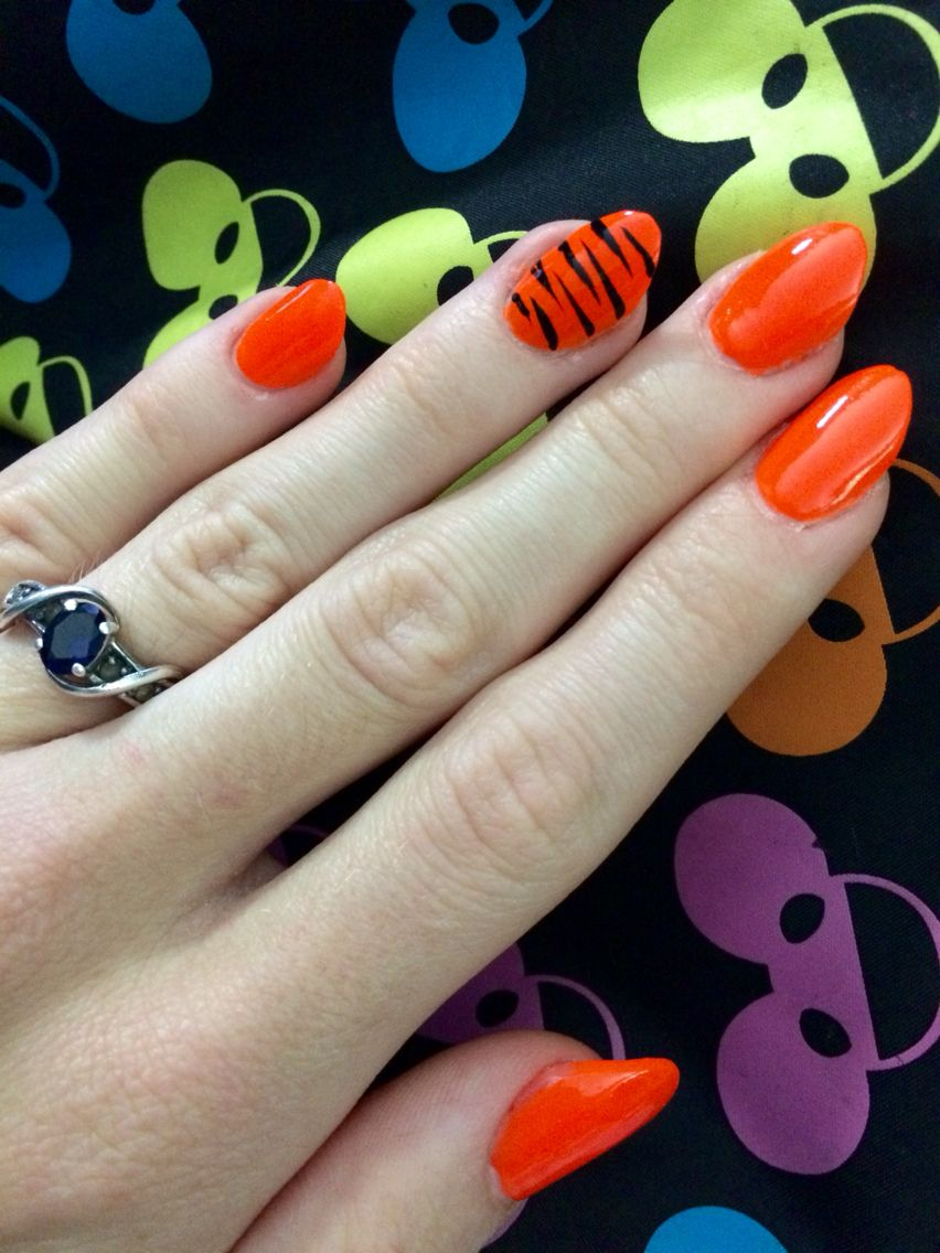 Acrylic almond shaped nails, bright orange tiger design