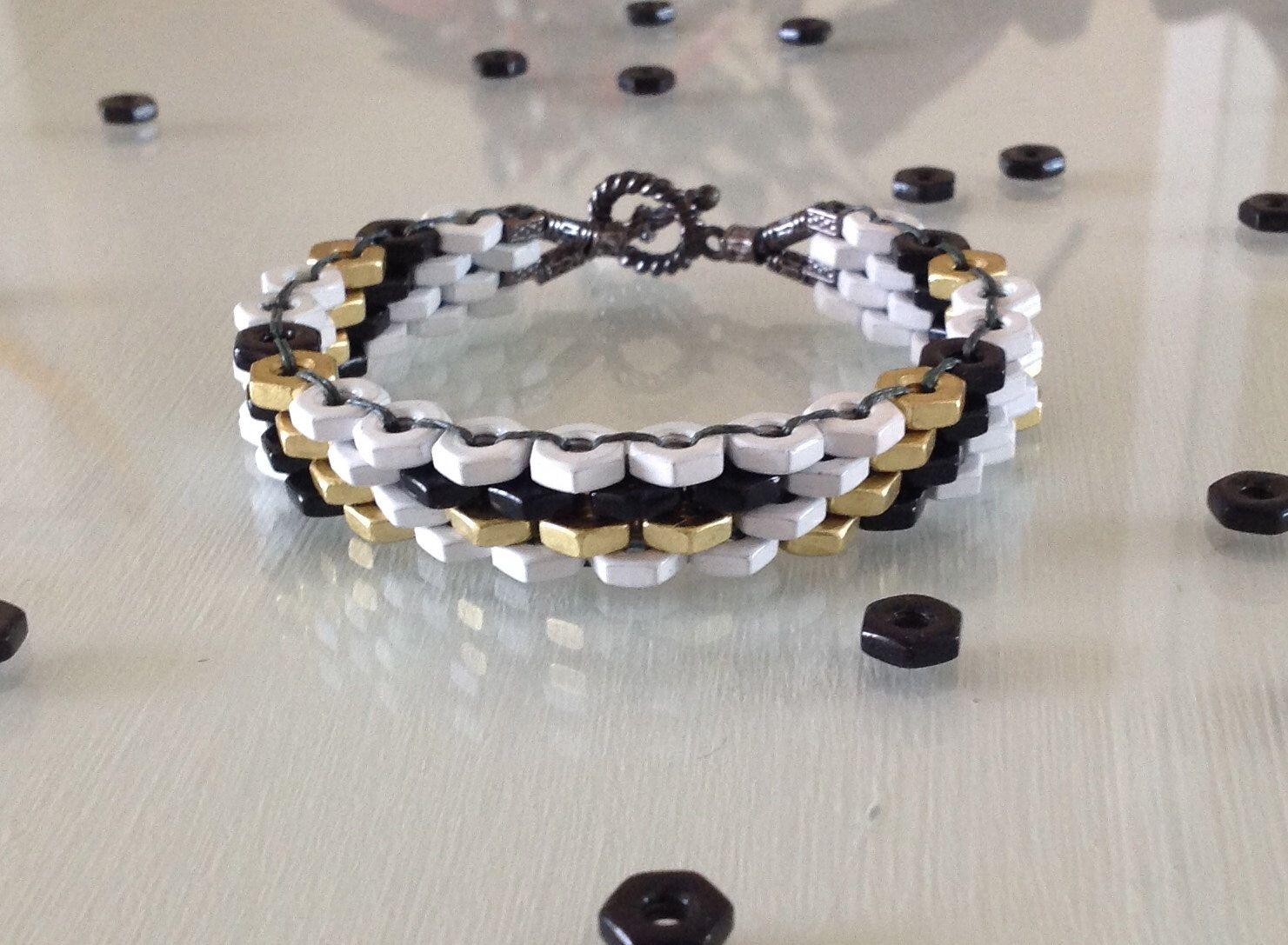 White Brass and Black Hex Nut Bracelet by BeautifulLanyards on Etsy https://www.etsy.com/listing/165988775/white-brass-and-black-hex-nut-bracelet