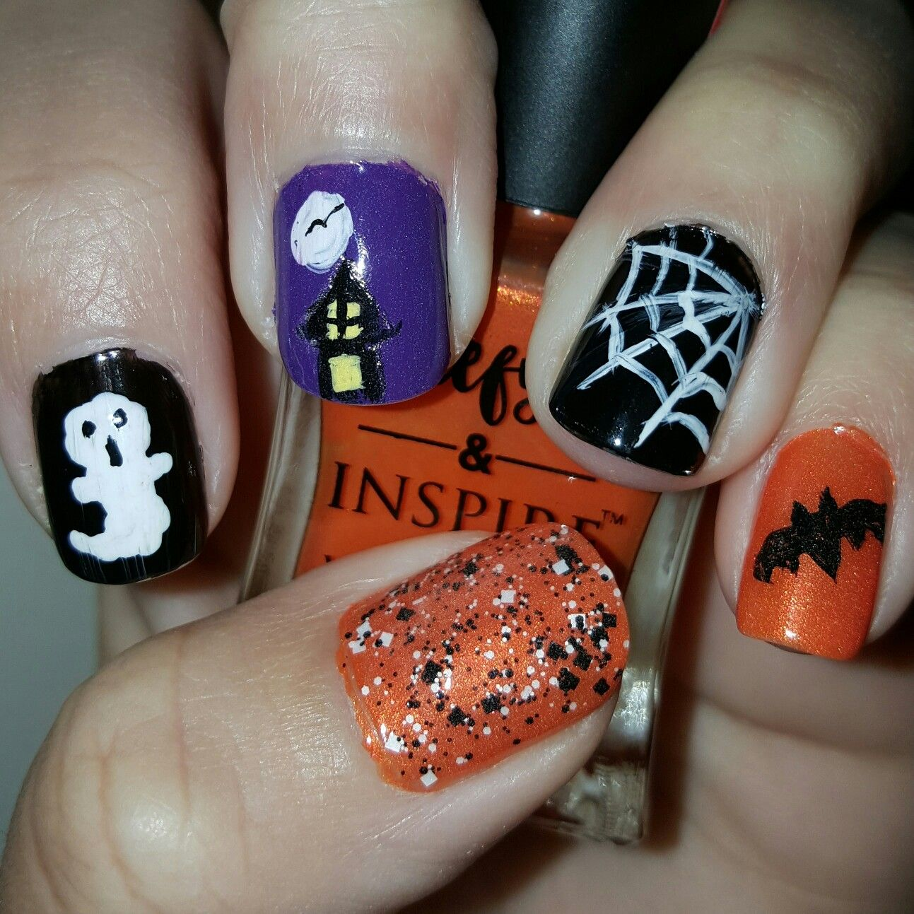 Halloween nails. Ghost, haunted house, spider web, bat and ...