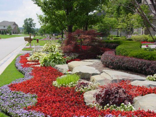 Landscaping With Annuals Flowers Front Yard Landscaping With Stone Retaining Walls And Annual