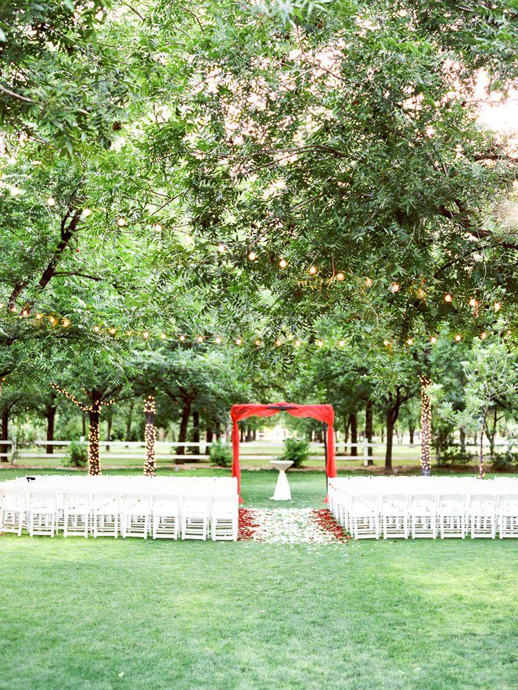 Arbor decor and aisle petals. Venue at the Grove in
