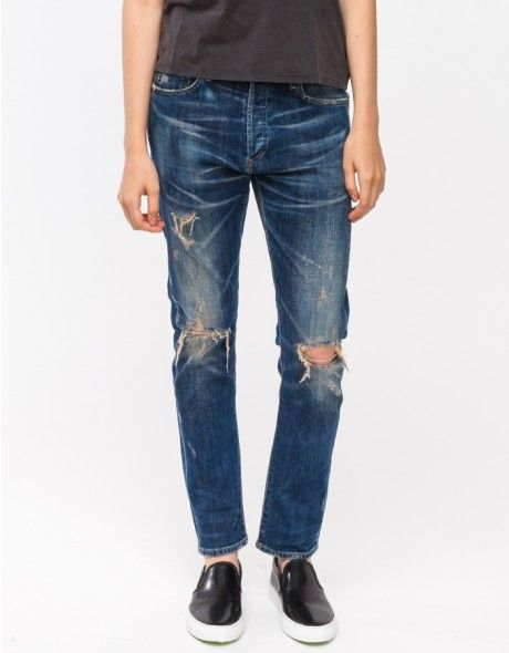 Slim fit drop-crotch jeans in a distressed vintage dirty bourbon wash from Citizens of Humanity. Features a button fly, 5-pocket styling, tobacco threading, front whiskering, and a slightly tapered leg.  	•	Slim fit drop-crotch jeans 	•	Distressed vint