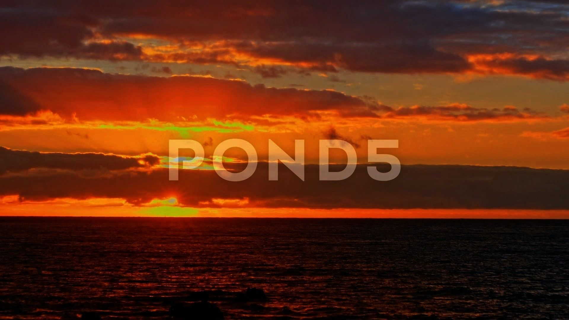 sunset dawn on the ocean The sun rises from beyond Stock Footage sunsetdawndramaticColorfulColorful bright dramatic sunset dawn on the ocean The sun rises from beyond Sto...