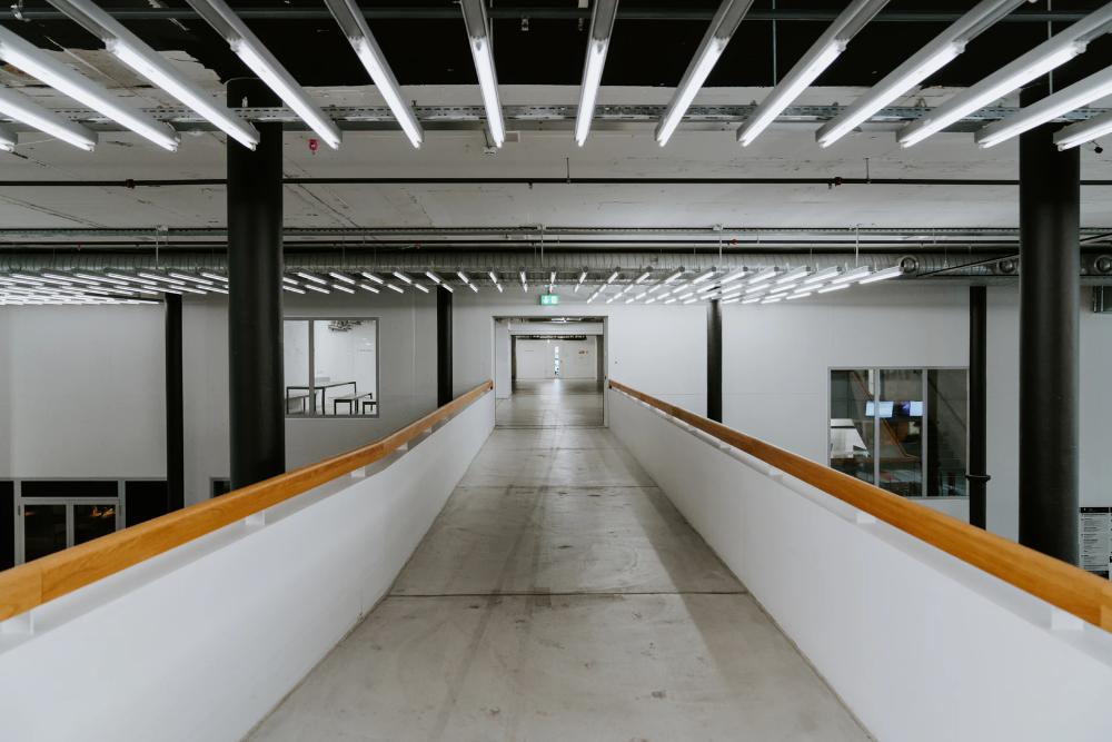 Empty Hallway Inside Building Photo Free Flooring Image On Unsplash Flooring Floor Lights Corridor