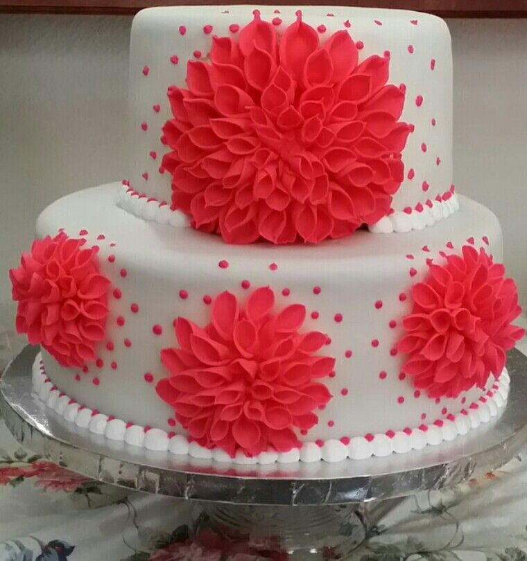 Quinceñera cake my husband made....flowers made by hand too.