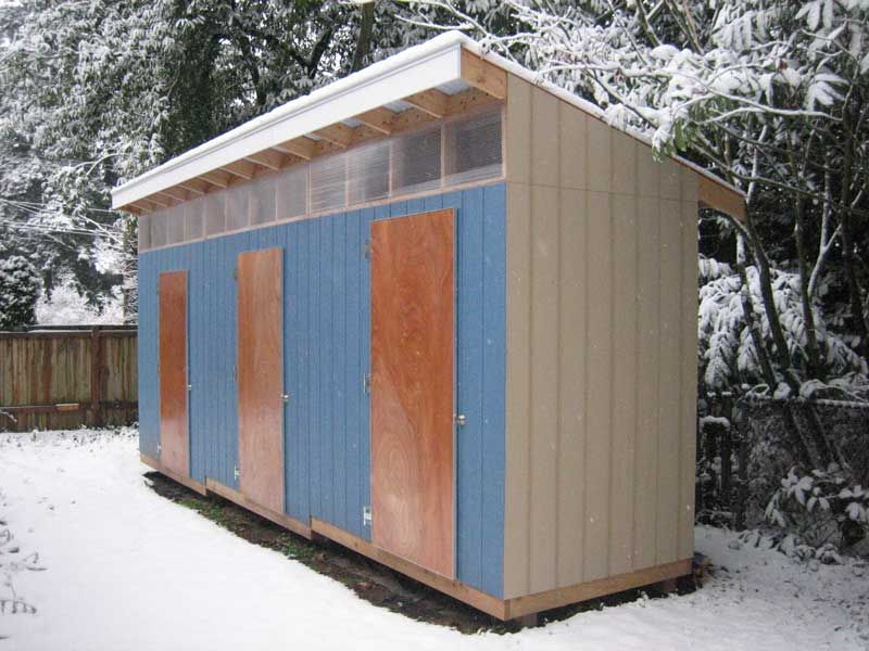 A finished backyard shed roofed with SUNTUF® Corrugated