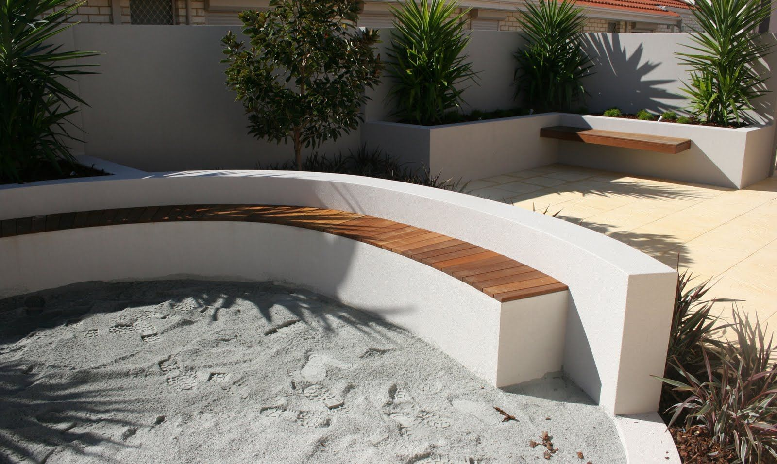 Rendered outdoor wall with seating green pinterest for Rendered garden wall designs
