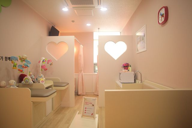 Japanese public nursing room/changing room/bottle making and bottle cleaning room. With curtains for privacy. In malls, department stores and airports all over Japan.