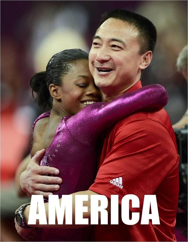 This is America: Gabby Douglas, 1st African American woman to win all-around gymnastics gold gets a big hug from her China-born coach, Liang Chow.