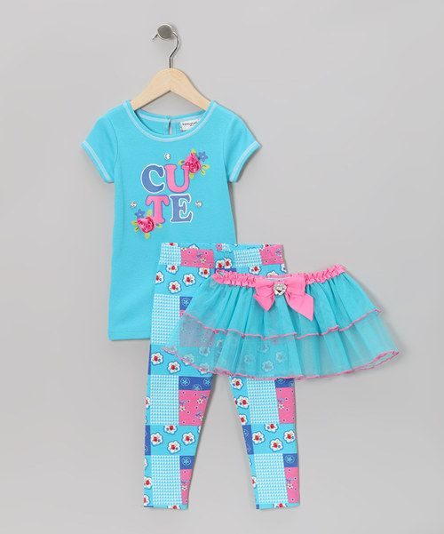 This terrific trio is the perfect outfit for any cheery affair. Its playful print and matching tutu are sure to turn heads and inspire smiles. Includes tee, tutu and leggingsTee: 60% cotton / 40% polyesterTutu: 100% polyesterLeggings: 95% cotton / 5% spandex
