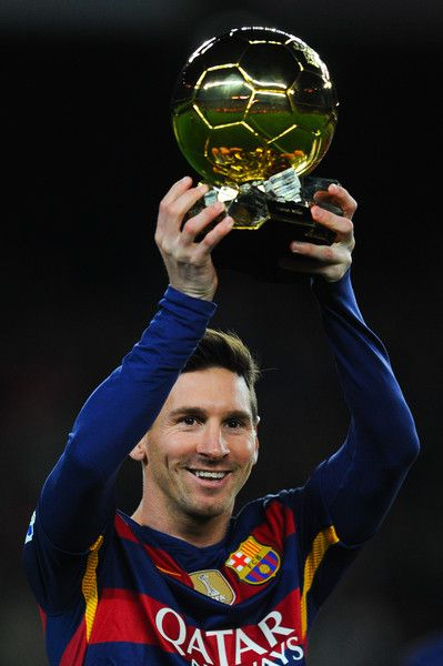 0d15c3eae1170 Lionel Messi of FC Barcelona holds up the FIFA Ballon d Or trophy prior to  the La Liga match between FC Barcelona and Athletic Club de Bilbao at Camp  Nou on ...