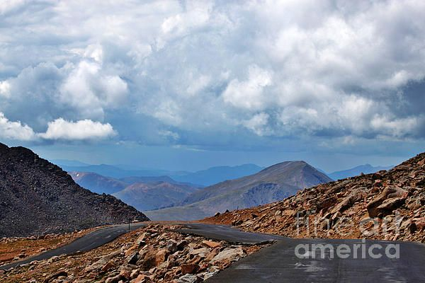 The climb down the highest paved Road in America, Mt. Evans, encounters a late Summer storm in the Rocky Mountains, Colorado's Front Range.