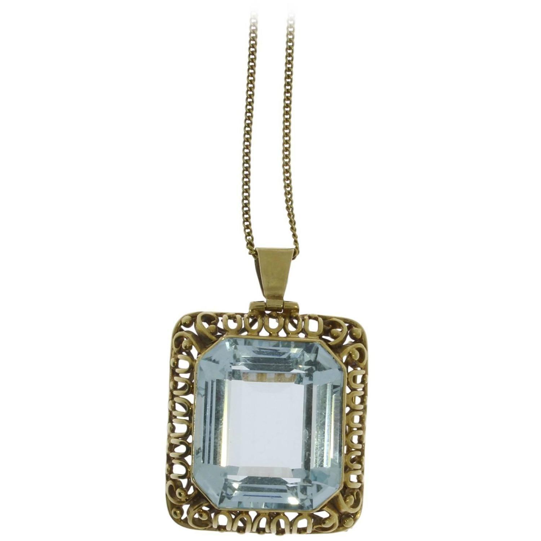 Large aquamarine gold pendant brooch gold pendant aquamarines large aquamarine gold pendant brooch aloadofball Gallery