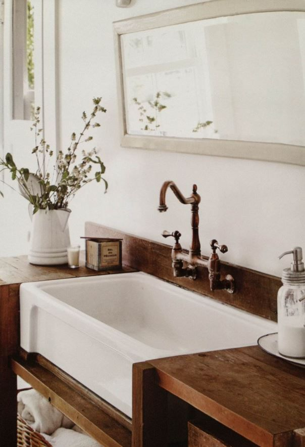 Great rustic bathroom sink! I believe this was in Country Living\u0027s