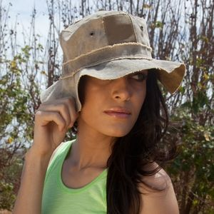 Beat the summer heat with a floppy hat made from recycled Brazilian cargo tarps!