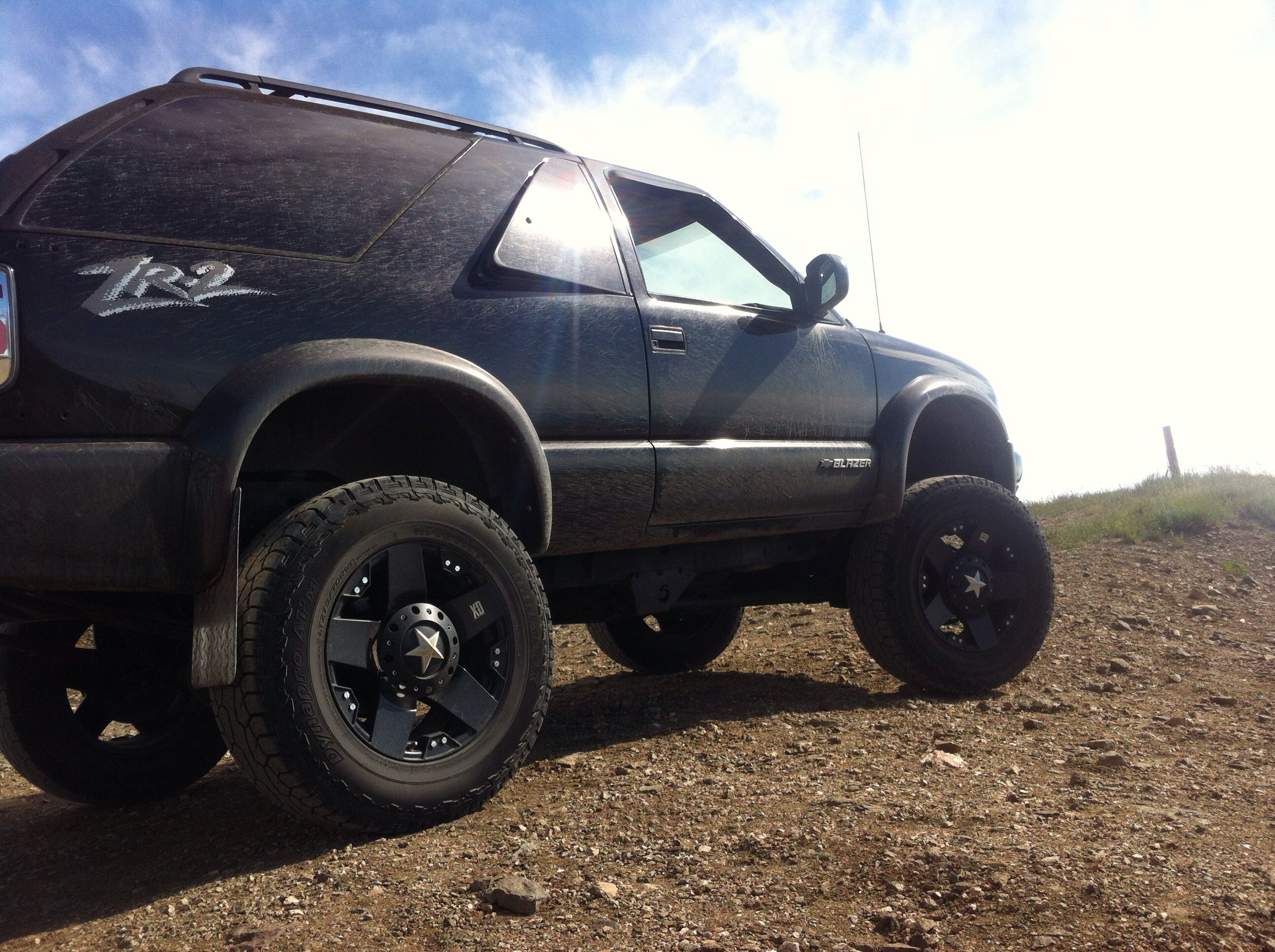 hight resolution of 04 chevy blazer with 6 inch super lift and 18 inch kmc rockstars sick