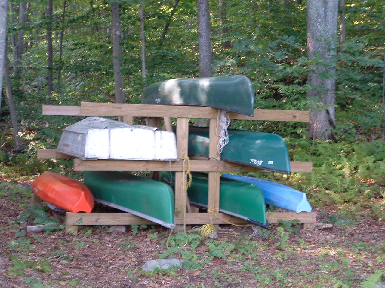 Small boat rack boat house pinterest boats and small for Boat storage garage