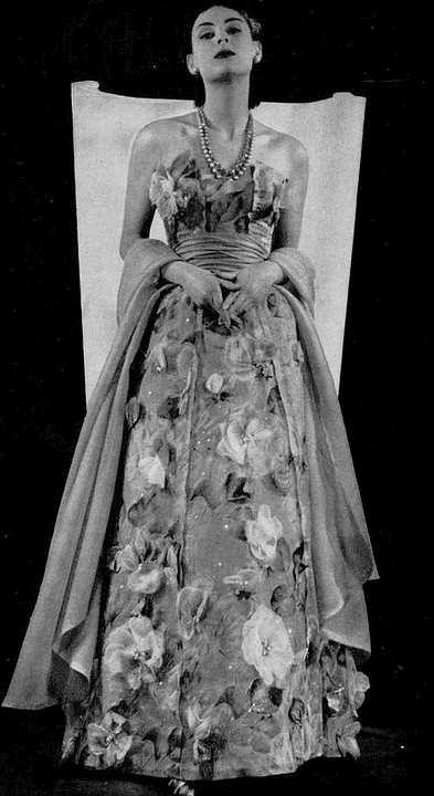 1952 Model in gorgeous evening gown of silk and organdy appliqued with organdy flowers, by Jacques Fath