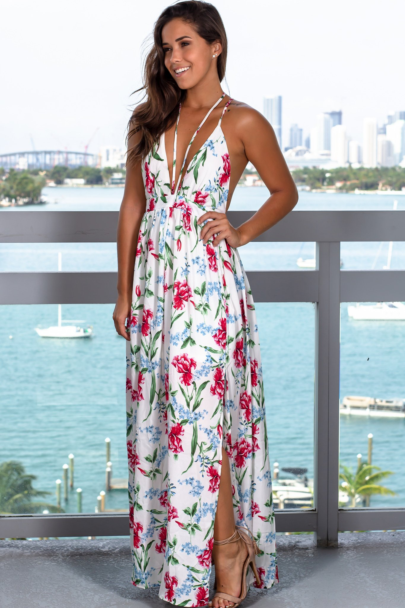 94968d0dd32 This Off White Floral Maxi Dress with Criss Cross Back is so beautiful!  Perfect for any special occasion this Summer. You can never go wrong with a  dress ...
