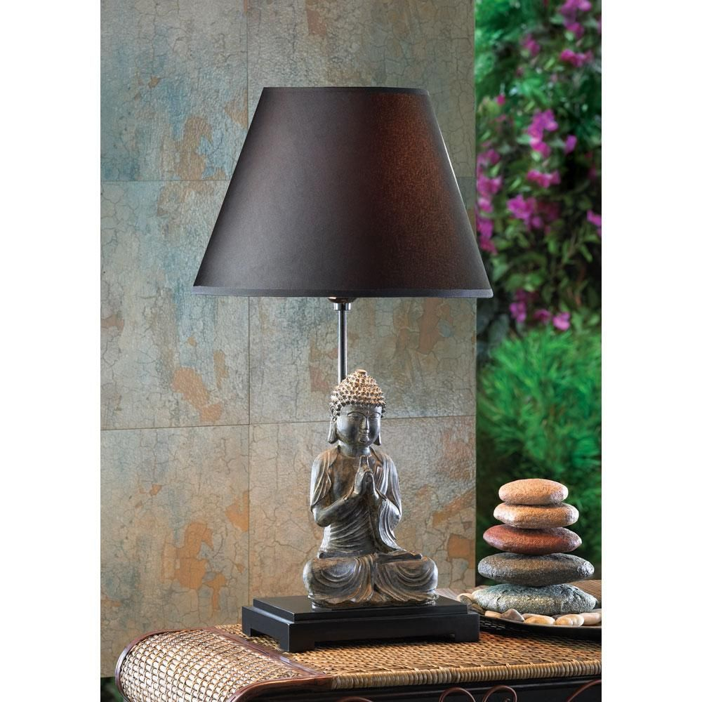 Enlightened light can be yours as this ancient-style Buddha figurine in the lotus position quietly meditates underneath a standard bulb. The dark shade and base make it thoroughly modern.Item weight: 3 lbs. Overall: 12½