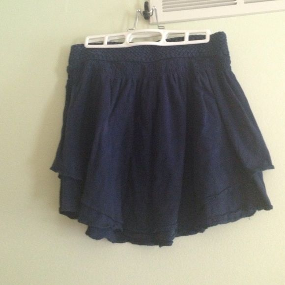 American eagle skirt Cute navy skirt. Braided detail on the waist. Layered bottom. Cute as a comfy cute with a tee shirt or perfect over a swim suit. Very versatile. Good condition. American Eagle Outfitters Skirts
