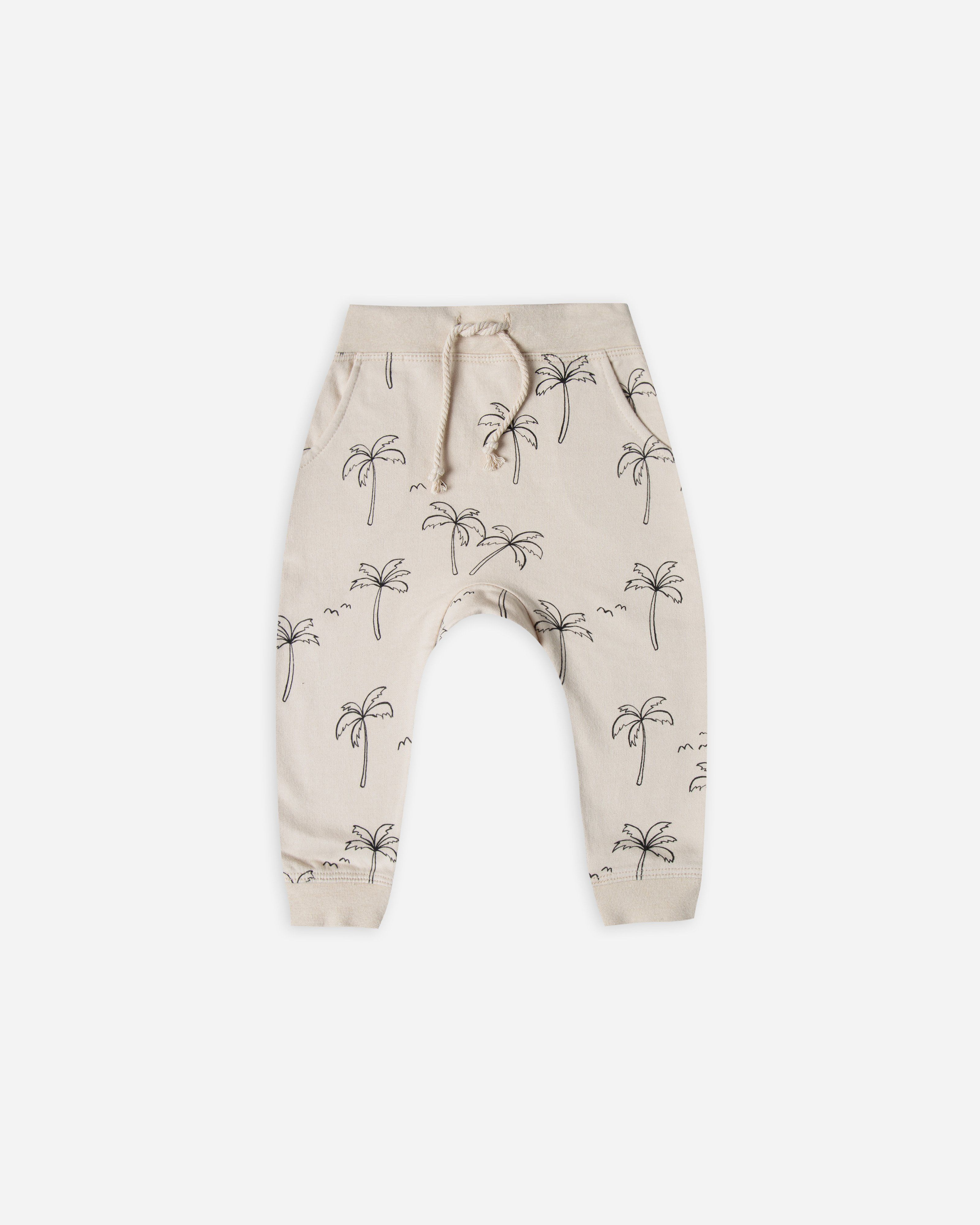 a08c693cd424 Sweatpant with all-over palm tree print. Side pockets