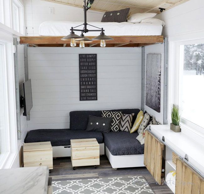Genius This Bed Lifts And Lowers At The Push Of A Button Tiny House Furniture Modern Tiny House Tiny House Storage