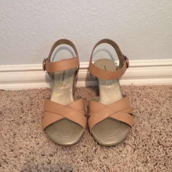 Bandolino wedge sandal Bandolino tan wedge sandal. Like new, rarely worn. Very comfortable, practical shoes for summer. Perfect for dressing up a casual outfit. Bandolino Shoes Wedges