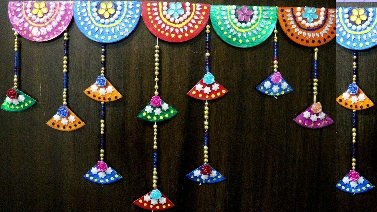 Best out of the waste wall hanging | Bandhanwar | Door hanging | Toran | Door hanging decorations, Diwali craft, Diy diwali decorations