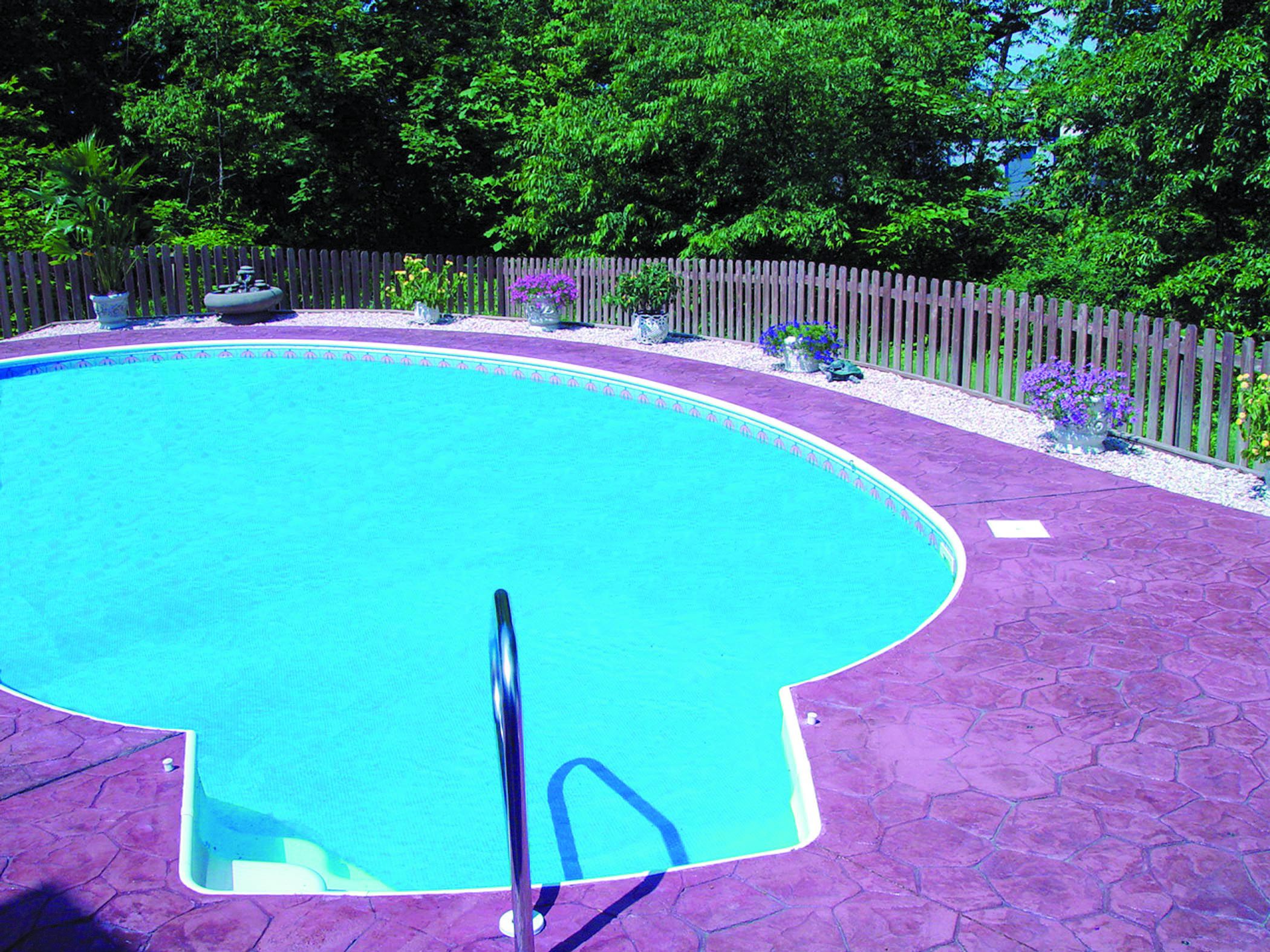 Bon Way Random Stone Stamped Concrete Around Pool #decorativeconcrete  #stainedconcrete