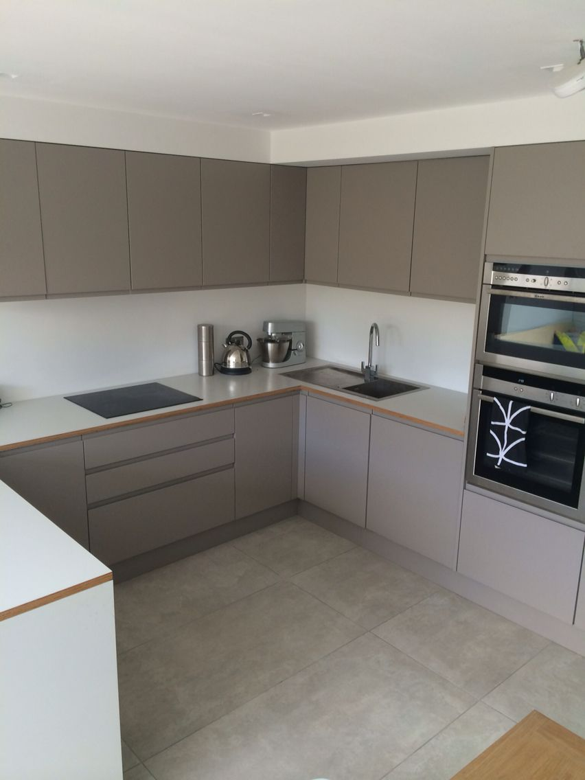 U-shape kitchen layout. Grey units and laminated ply ...