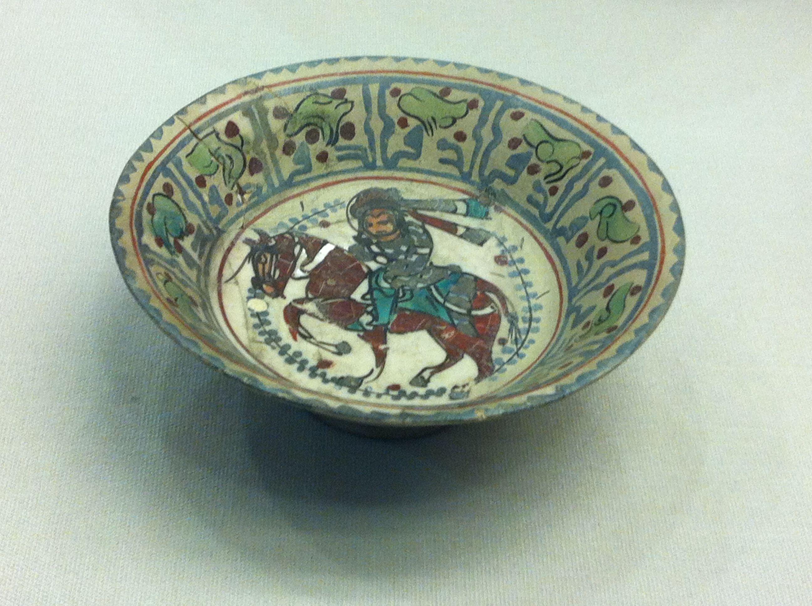 Stone-paste bowl, decorated in the 'minai' technique. C12th-C13th, Kashan, Iran.