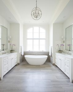 traditional bathroom lighting ideas white free standin. Facing Bathroom Vanities With A Freestanding Tub And White Oak Floors Traditional Lighting Ideas Free Standin R