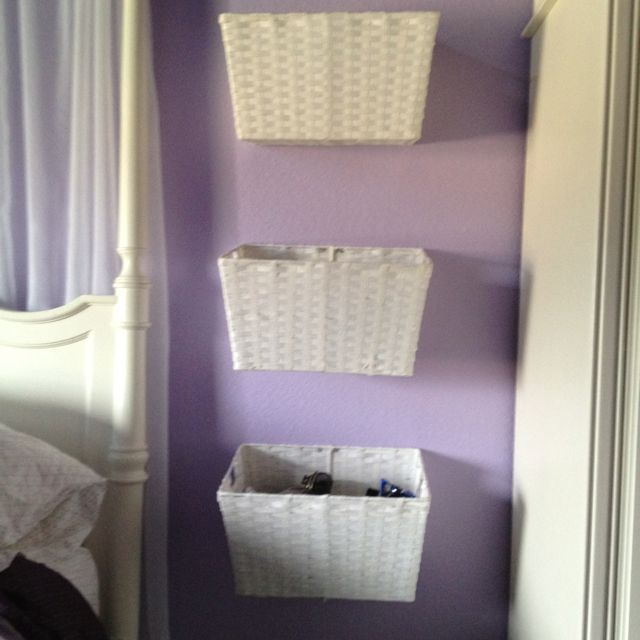 Hang baskets on the wall for storage and decor for teens