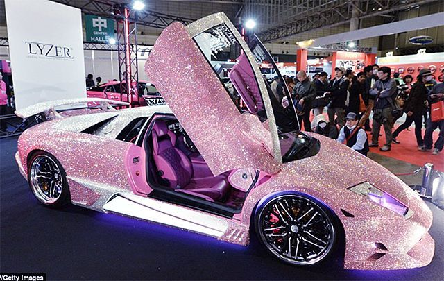 The term voiture de luxe is used for luxury cars. I guess if you have the money for a Lamborghini, you can