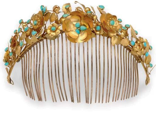 Circa 1870 wide tapered hair comb surmounted by an arched band of sculpted yellow metal and cabochon turquoise flowers, vine, and leaf clusters.