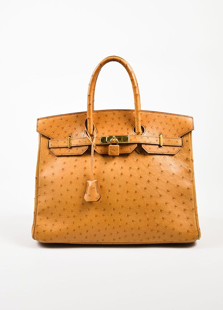 3cfc9acec70 This luxurious 35cm size Birkin handbag is a warm orange-tan