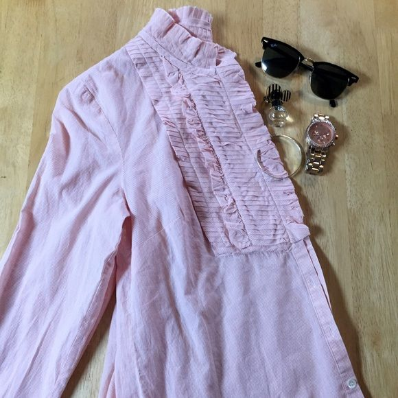 J. Crew Ruffle Front Button Down Chic ruffle front button down top from J. Crew. The pretty pale pink color is extremely flattering and easy to pair with bottoms, shoes and accessories. EUC and the prefect addition to any closet!  J. Crew Tops Button Down Shirts