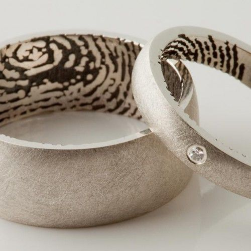 Simple Fingerprint wedding rings by Fluid Forms D printed then lost wax cast in silver