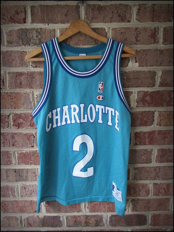 c581cc925e9 Vintage 80's NBA Charlotte Hornets Larry Johnson Champion Jersey by  CharchaicVintage, $30.00