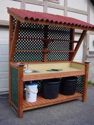 Awesome potting bench with sink                                                                                                                                                                                 More