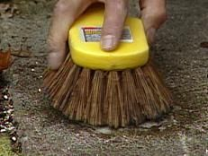 Use Stain Remover And Stiff Bristle Brush To Clean Garden