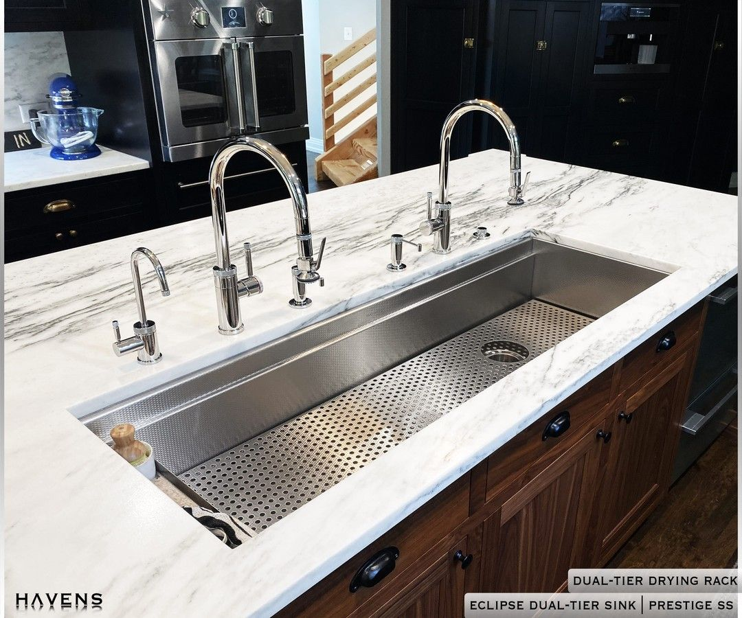 The Eclipse Sink In A 54 Inch Size Featuring Two Faucets And A